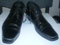 Пара ботинок мужских  фирмы «***»